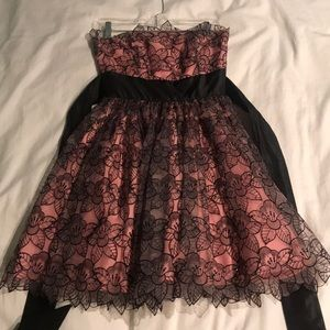 Pink with black floral top layer strapless dress.